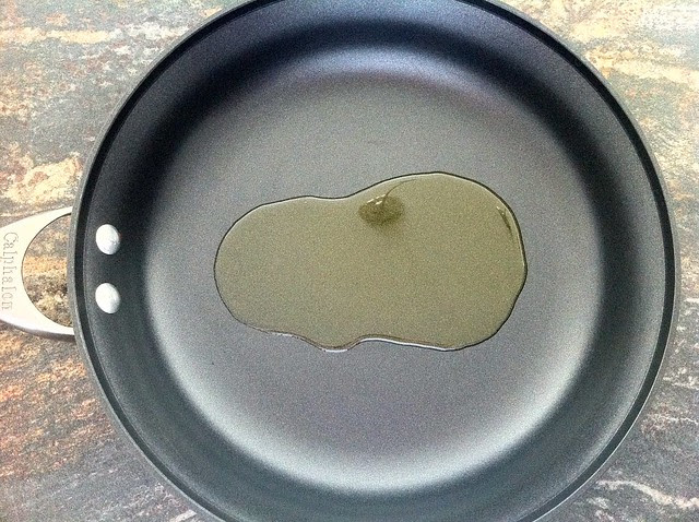 Extra Virgin Olive Oil Added to Saute Pan