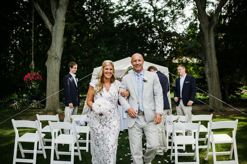 Photos of family and friends with the bride and groom following a small backyard wedding ceremony in Rockford IL. Photo by Mindy Joy Photography