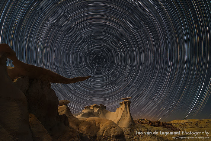 Moonlight illuminates The Wings formation and stars form trails at Bisti badlands