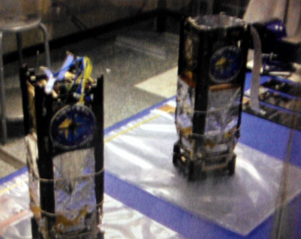 Waiting for launch vehicles and launch dates to be chosen, the twin Lightsail spacecraft are secured inside a cleanroom in early 2012.