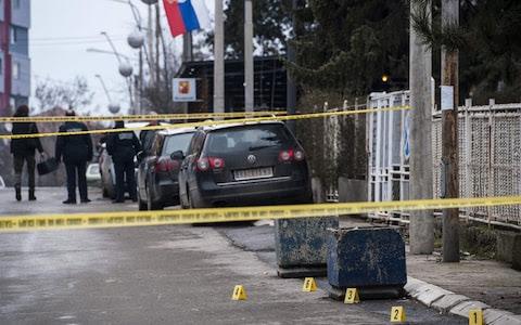 Kosovo police officers secure the area where leading Kosovo Serb politician Oliver Ivanovic was killed in Mitrovica