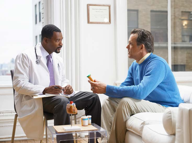 Doctor talking with a patient about his medicine