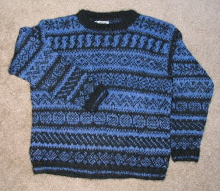 Pullover hand knit in black and royal blue handspun yarns.