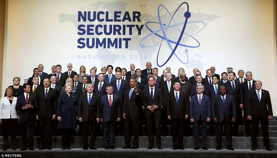 Peace, man: Surrounded by world leaders, President Barack Obama gave the peace sign at the end of a nuclear security summit today