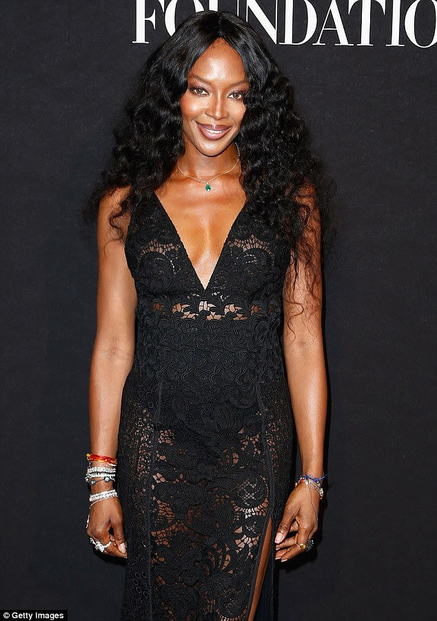 Say cheese: Naomi, who cut her teeth in the fashion scene in the late 80s, saucily swaggered into the glitzy event in the French capital - smiling and pouting as if she were back on the runway