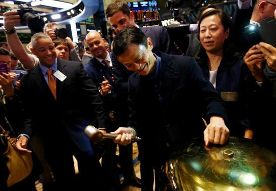 Alibaba Group Holding Ltd founder Jack Ma (C) rings a ceremonial bell to start trading during his company's initial public offering (IPO) under the ticker 'BABA' at the New York Stock Exchange in New York September 19, 2014.        REUTERS-Brendan McDermid
