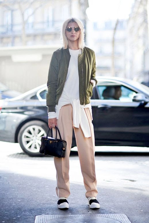 Le Fashion Blog Pfw Street Style Fresh Spring Color Combo Round Sunglasses Green Bomber Jacket White Tie Front Sweater Pink Trousers Black And White Chunky Sneakers Via Harpers Bazaar Australia