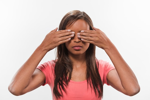 Download Portrait Of An African Teenage Girl Covering Her Eyes for free