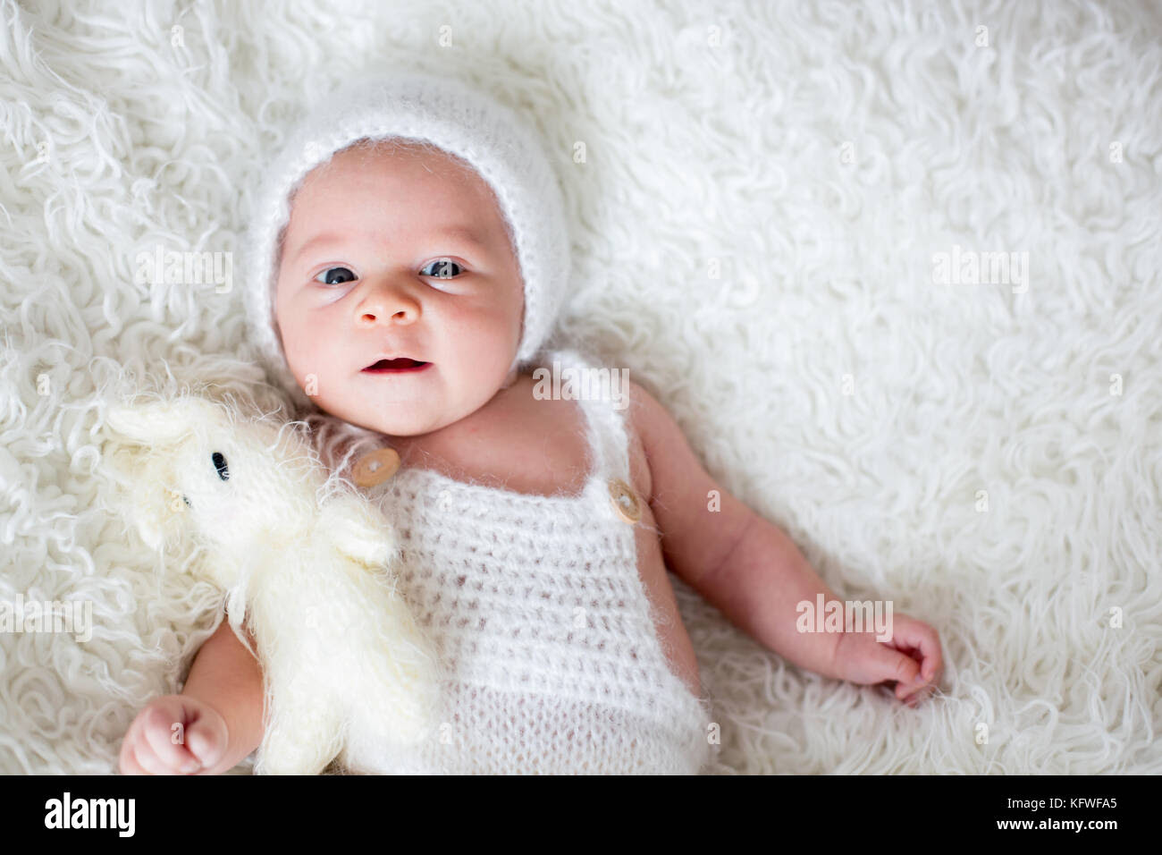 Beautiful Newborn Baby Boy Looking Curiously At Camera Smiling