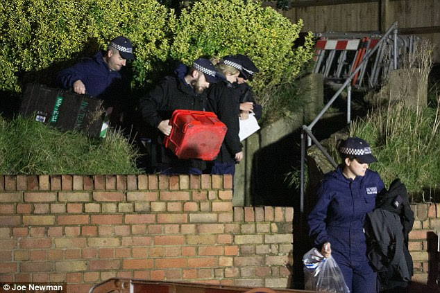 Officers carried evidence bags and plastic bottled as they left the home of the former EastEnders actress