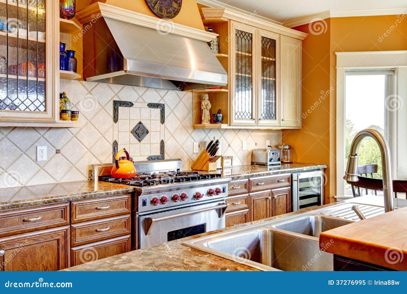 Wood Kitchen Room With Decorated Tile Backsplash Royalty Free