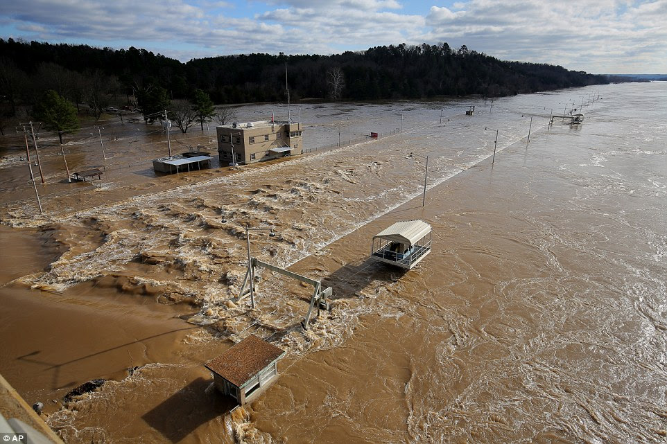 Up to 17million people and thousands of homes in Illinois and Missouri are under threat from the floods, with swollen rivers and streams pushed to virtually unheard of heights. Pictured, the Toad Suck Ferry Lock and Dam, in Conway, Arkansas, floods