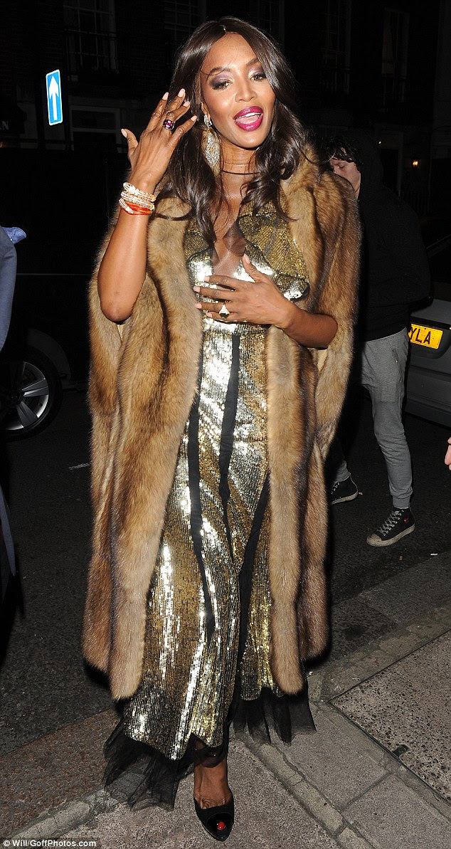 Here she comes: Climbing from the rear of her car, Streatham born Naomi, 46, stunned in a plunging metallic gown with tulle underlay as shearrived at upmarket Mayfair club Mark¿s ahead of an exclusive party held on behalf of fashion photographers Mert and Marcus