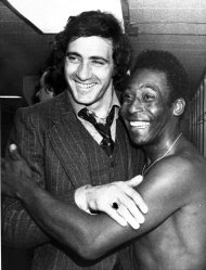 FILE - In this May 2, 1976, file photo, New York Cosmos' star Pele, right, and Italian soccer star Giorgio Chinaglia get together in the Cosmos' locker room in New York. Former Italy and Cosmos star Chinaglia died in his home in Florida, Sunday, April 1, 2012, his son Anthony Chinaglia said. (AP Photo/File)