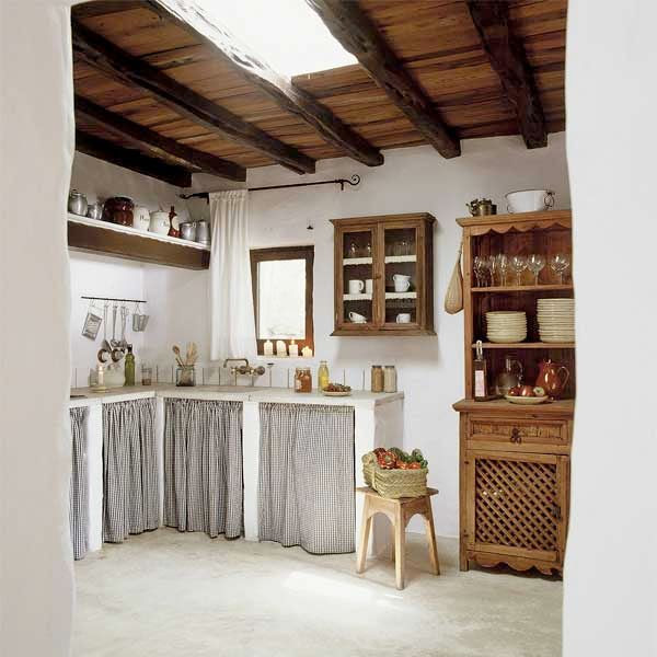 lot of good ideas here...i like the fabric covering the cab nits instead of wood doors, because it would help things inside not mold...i also like the wood cabinet with the lattice work door
