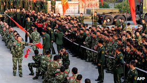 Soldiers of China's People's Liberation Army undergoing a tug-of-war at a military base in Hefei in December 2011