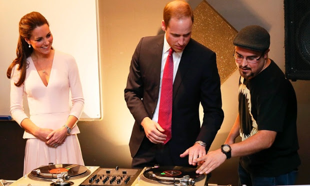 Catherine, Duchess of Cambridge looks on as Prince Willaim learns to spin some tracks on DJ decks at a youth community centre near Adelaide, Australia.