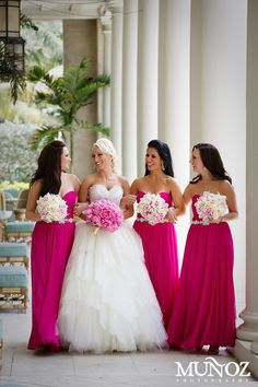 Pink bridesmaids carry white flowers and bride carries pink.. Maybe white with a few pink