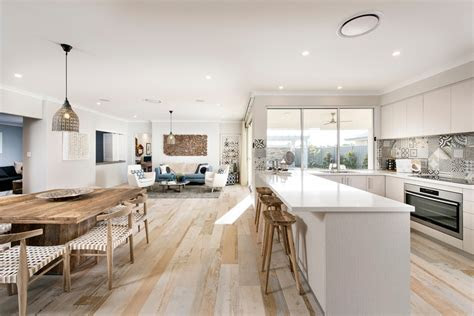 Amazing Scandinavian Open Floor Plan Kitchen With White Counters And Wood Dining Set And A
