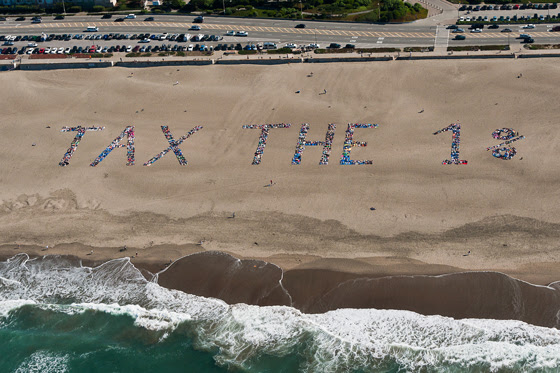 BEACH_HUMAN_BANNER_TAX_THE_1_2.jpg