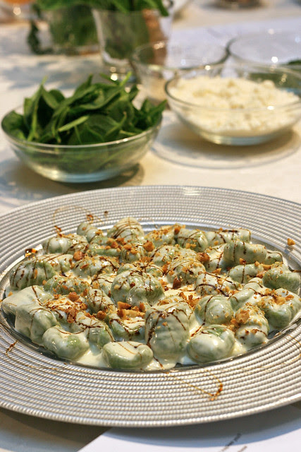 Homemade Spinach and Potato Dumpling with a Gorgonzola Cheese Sauce, Toasted Walnuts and a Balsamico Glaze