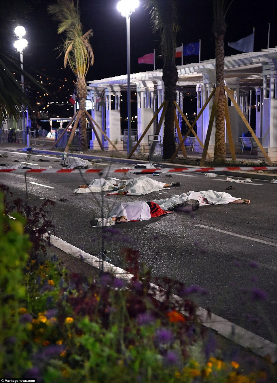Death toll: At least ten people lie dead on a short stretch of road where the lorry flew through crowds in Nice, killing families on a national holiday