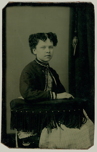 Girl in fringed chair