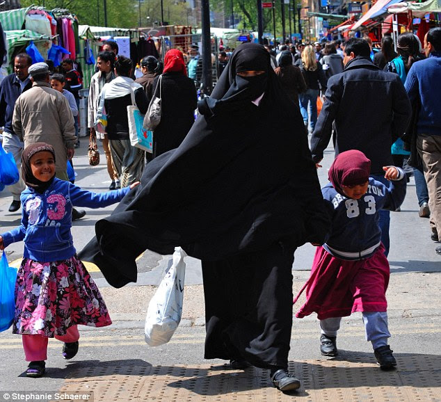 In some inner city wards the percentage of Muslim pupils is very high, with more than 60 per cent of children in schools in Tower Hamlets, where this family was pictured, identifying as Muslim