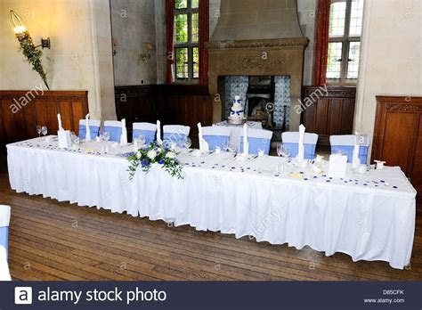 Head table at wedding reception with blue and white