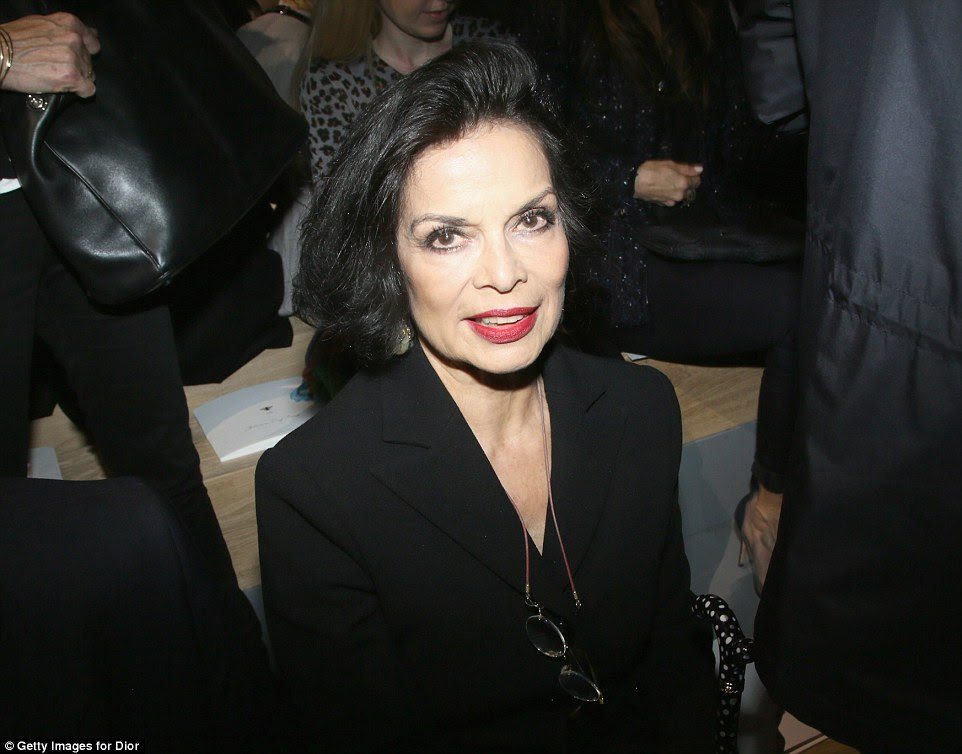 Still got it:Bianca Jagger, 71, was elegant in a black blazer as she took her seat on the front row
