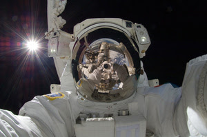 Incredible photo of Earth and the ISS reflected in an astronaut's helmet