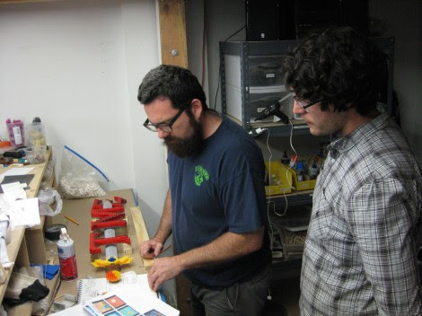 Here's Chris showing Nate how legos work.