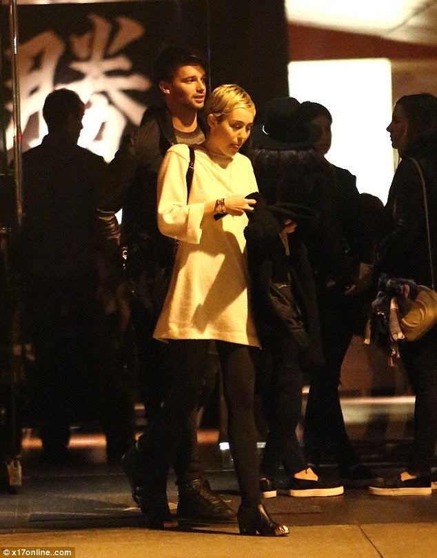 Going public: Miley and Patrick reportedly dated for a short time in 2011 but rekindled their flame recently