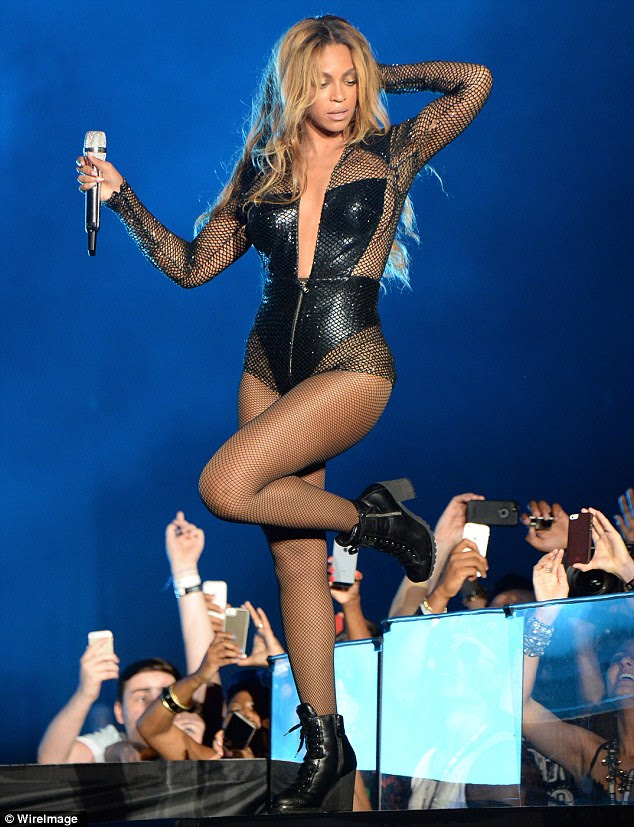 Sizzling: Beyonce, 32, was swathed in a fishnet and leather body suit, complete with high-heeled combat boots