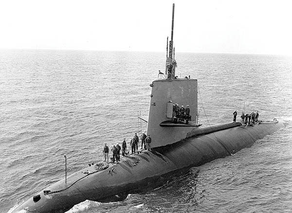 Scorpion crewmen come topside in April 1968 as the sub nears another American ship.