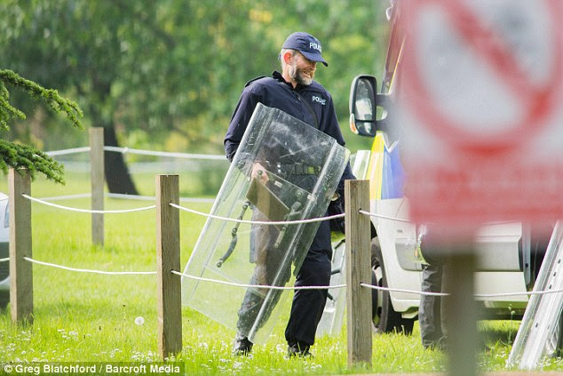 Police officers carrying riot shields were this evening seen searching parkland as they continue their hunt