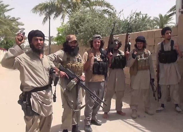 Conquered: ISIS jihadi's celebrate taking the town of Ramadi which lies just 60 miles west of Iraq's capital Baghdad