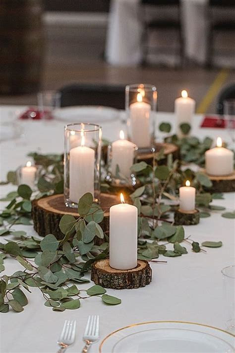 Picture Of rustic centerpiece with greenery, wood slices