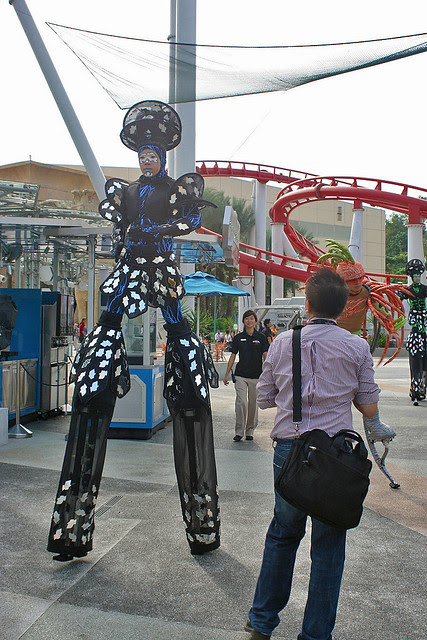 Modern stiltwalkers with new-fangled metal stilts and jumping stilts