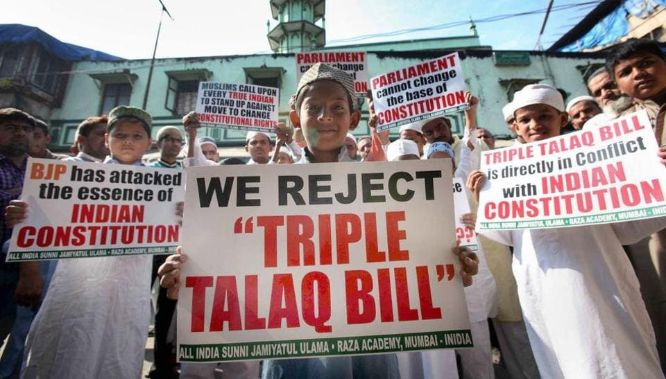 Muslims pose with placards to protest against the government over Triple Talaq Bill in Mumbai