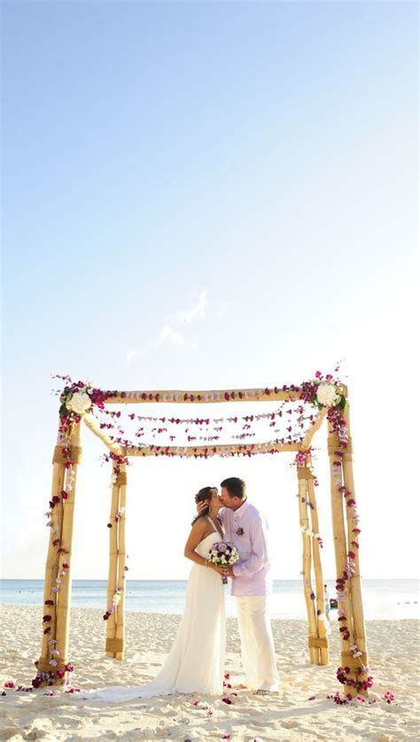 beach wedding bamboo arch by Celebrations Ltd   Cayman