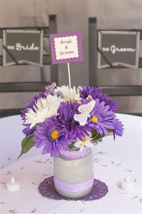 Centerpiece, purple daisies with butterfly   Wedding Recycle