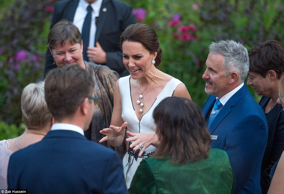 Pictured is Kate Middleton speaking to guests at The Queen's Birthday Garden Party at The Orangery in Warsaw tonight