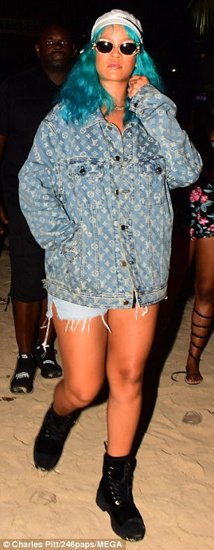 Sartorially savvy: Rihanna is known to take risks when it comes to her style and teamed her colourful bonce with a barely-there double denim outfit