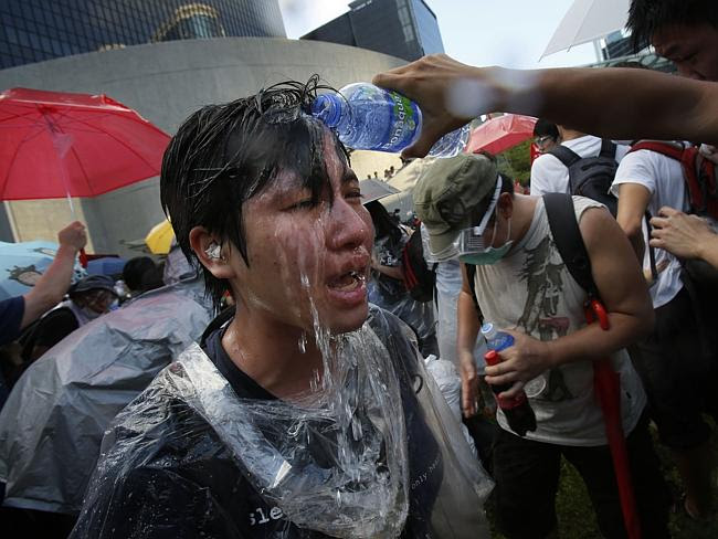 Hurt ... a student protester is overcome by pepper spray from riot police. Picture: AP