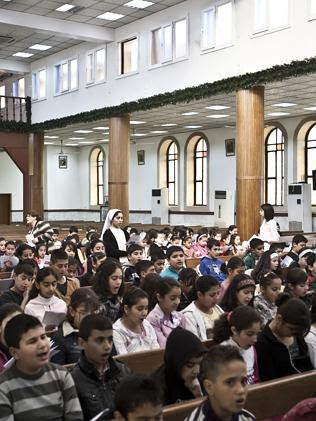 Christian youngsters participate in a service at St Joseph Cathedral.