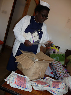 Matron Catherine Mzembe examines expired surgical gloves that have been donated to Embangweni Mission Hospital in Malawi