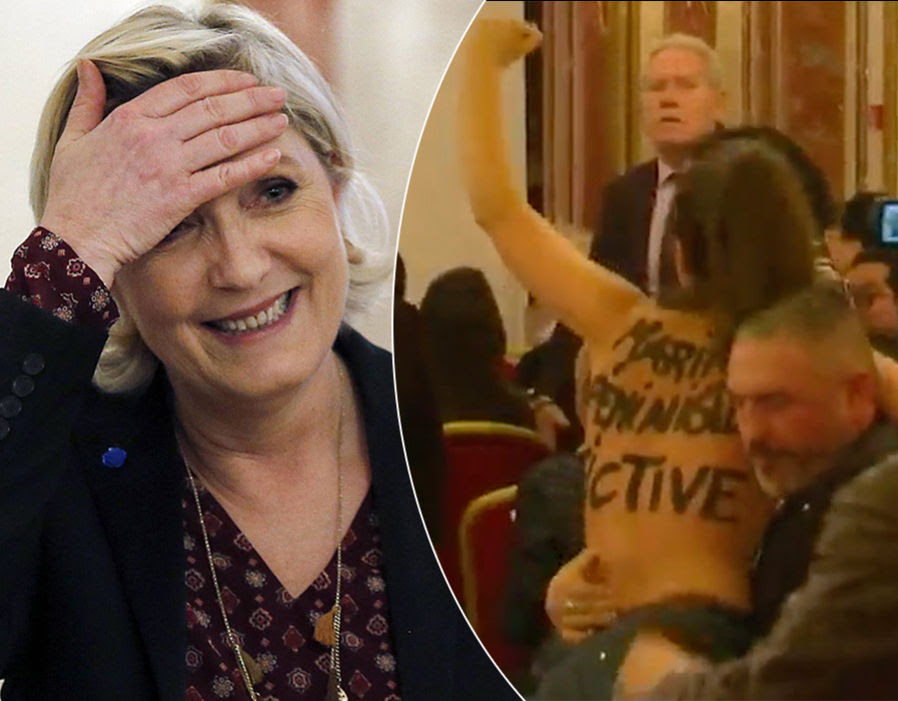 Marine Le Pen gestures after a press conference focused on the theme 'France's international policy in a multipolar world'