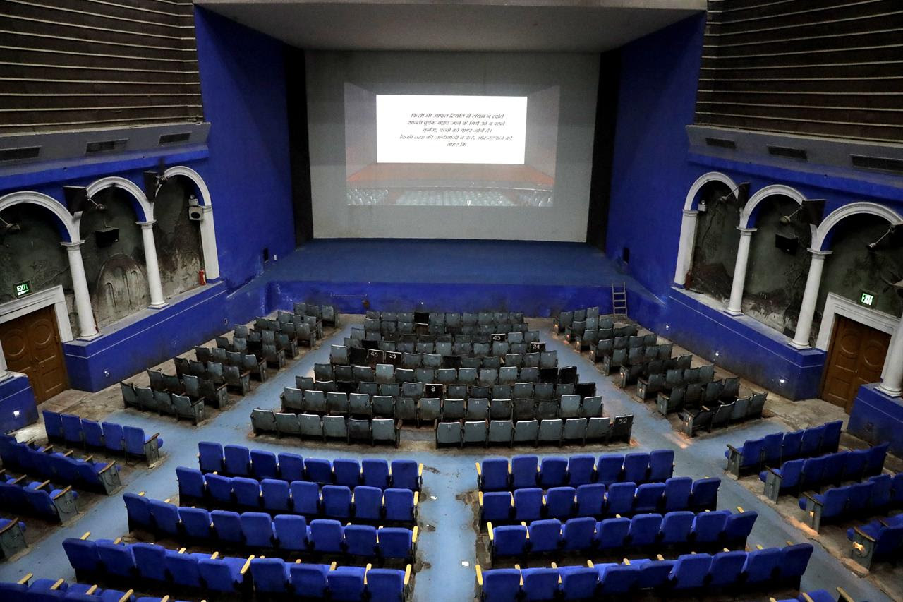 This Thursday, March 30, 2017 photo shows an overview of the colonial era Regal Theater in New Delhi, India. The Indian capital's iconic theater signed off on Thursday night after more than eight decades with nearly 600 movie buffs cheering a 1964 Bollywood classic at a final screening. It's expected to make way for a multiplex from a single screen.
