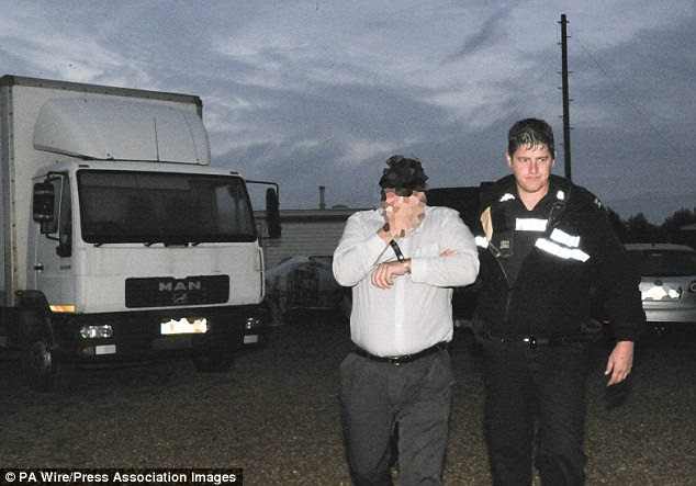 Crackdown: Police raid a traveller site in Cambridge during a massive police operation to arrest a gang of criminals behind burglaries of museums and auction houses across Europe